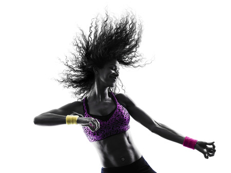Photo pour one african woman woman zumba dancer dancing exercises in studio silhouette isolated on white background - image libre de droit