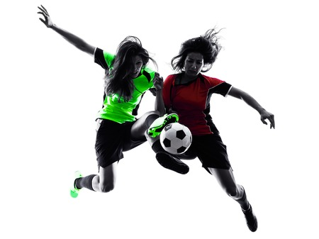 Photo pour two women playing soccer players in silhouette isolated on white background - image libre de droit