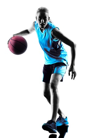Photo for one  caucasian woman basketball player dribbling in silhouette isolated white background - Royalty Free Image