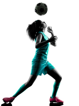 Photo for one teenager girl child  playing soccer player in silhouette isolated on white background - Royalty Free Image
