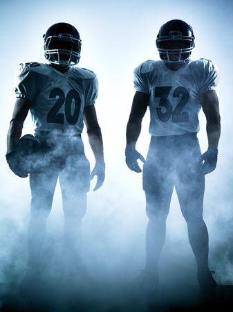 Foto de one american football players portrait in silhouette shadow on white background - Imagen libre de derechos
