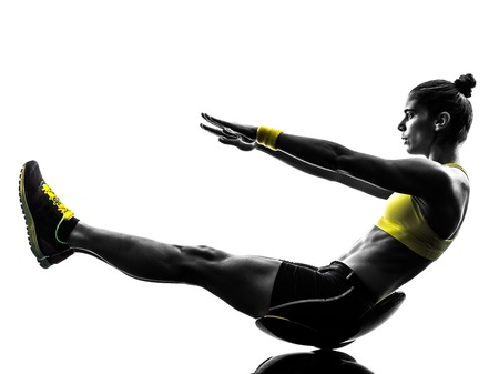 Photo for one caucasian woman exercising  crunches fitness in studio silhouette isolated on white background - Royalty Free Image