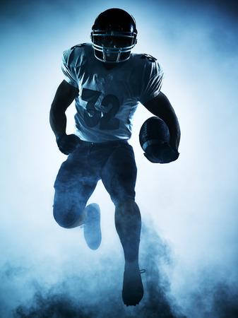 Foto de one american football player portrait in silhouette shadow on white background - Imagen libre de derechos