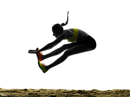 Photo for one woman praticing Long Jump silhouette in studio silhouette isolated on white background - Royalty Free Image