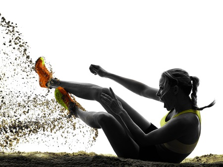 Photo pour one woman praticing Long Jump silhouette in studio silhouette isolated on white background - image libre de droit