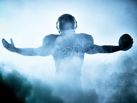 Photo pour one american football player portrait in silhouette shadow on white background - image libre de droit