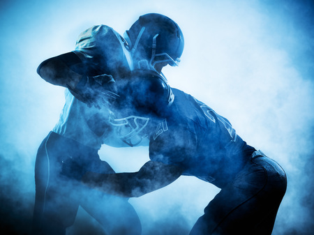 Photo pour one american football players portrait in silhouette shadow on white background - image libre de droit