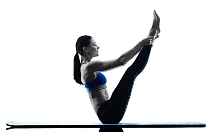 Photo for one caucasian woman exercising pilates exercises fitness in silhouette isolated on white backgound - Royalty Free Image