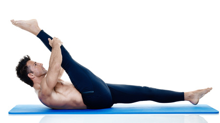 Photo for one caucasian man exercising fitness pilates exercices isolated on white background - Royalty Free Image