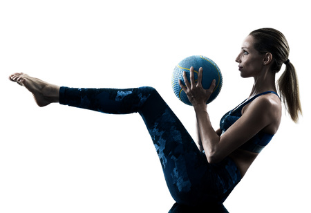 Photo for one caucasian woman exercising fitness Medicine Ball excercises in silhouette isolated on white background - Royalty Free Image