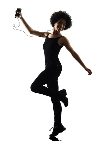 Photo pour one mixed race african young teenager girl woman happy dancer dancing  listening music in studio shadow silhouette isolated on white background - image libre de droit