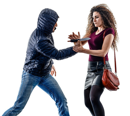 Photo pour one caucasian woman victim of a thief aggression self defense isolated on white background - image libre de droit