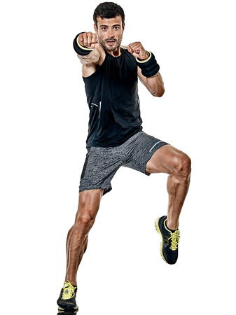 Foto de one caucasian fitness man exercising cardio boxing exercises in studio  isolated on white background - Imagen libre de derechos