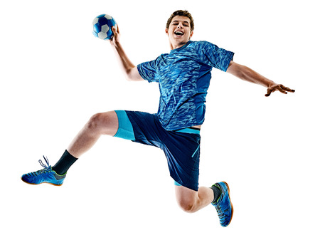 Foto de one caucasian handball player teenager boy in studio isolated on white background - Imagen libre de derechos