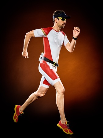 Photo pour one caucasian  man runner running  triathlon ironman isolated - image libre de droit