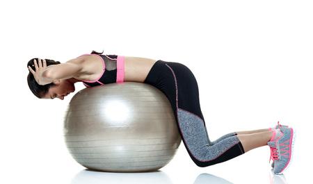Foto de one mixed raced woman exercising fitness exercises isolated on white background - Imagen libre de derechos