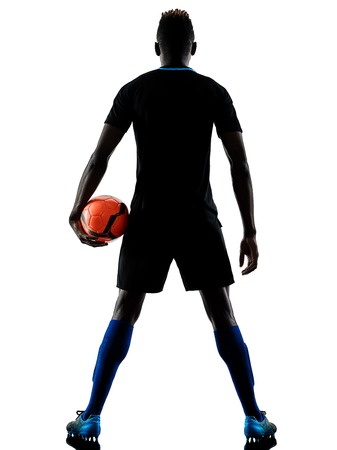 Photo for one african soccer player man playing in studio isolated on white background - Royalty Free Image