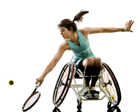 Foto de one caucasian young handicapped tennis player woman in welchair sport  tudio in silhouette isolated on white background - Imagen libre de derechos