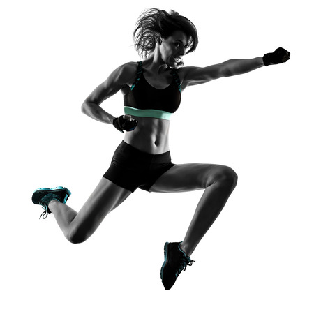 Foto de one caucasian woman exercising cardio boxing cross core workout fitness exercise aerobics silhouette isolated on white background - Imagen libre de derechos