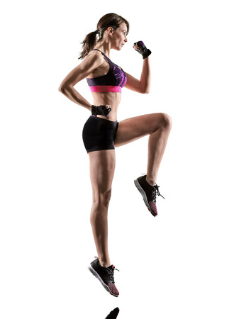 Photo for one caucasian woman exercising cardio boxing cross core workout fitness exercise aerobics silhouette isolated on white background - Royalty Free Image