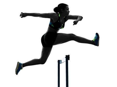 Foto de one african runner running hurdlers hurdling  woman isolated on white background silhouette - Imagen libre de derechos
