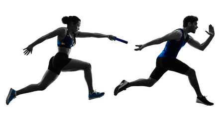 Foto de athletics relay runners sprinters running runners in silhouette isolated on white background - Imagen libre de derechos