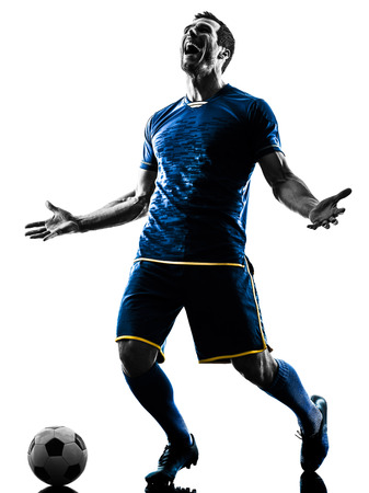Photo pour one caucasian soccer player man happy celebration  in silhouette isolated on white background - image libre de droit
