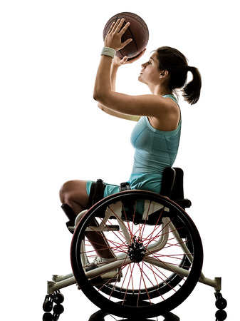 Photo pour one caucasian young handicapped basket ball player woman in wheelchair sport  tudio in silhouette isolated on white background - image libre de droit