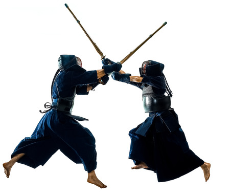 Foto de two Kendo martial arts fighters combat fighting in silhouette isolated on white bacground - Imagen libre de derechos