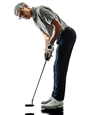 Photo for one caucasian senior man golfer golfing  in studio shadow silhouette isolated on white background - Royalty Free Image
