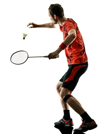 Photo for one caucasian Badminton player man in studio shadow silhouette isolated on white background - Royalty Free Image