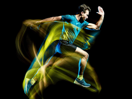 Foto de one caucasian runner running jogger jogging man light painting speed effect  isolated on black background - Imagen libre de derechos