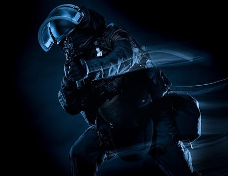 Foto de one soldier police swat tactical forces man studio shot  isolated on black background - Imagen libre de derechos