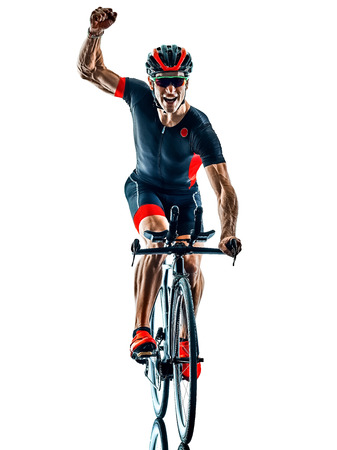 Foto de triathlete triathlon Cyclist cycling  in studio silhouette shadow  isolated  on white background - Imagen libre de derechos