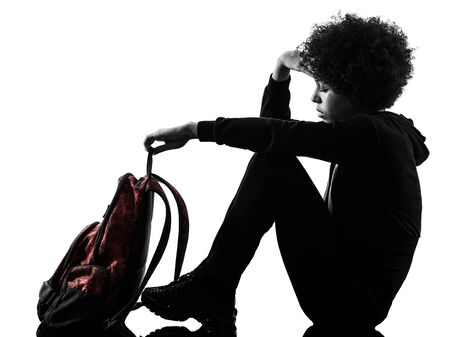 Foto de one mixed race african young teenager girl woman sadness depression in studio shadow silhouette isolated on white background - Imagen libre de derechos