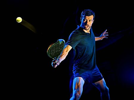 Photo for one caucasian Paddle tennis player man studio shot isolated on black background with light painting blur effect - Royalty Free Image