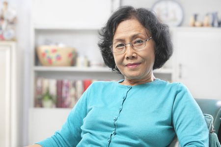Senior Asian woman relax at home