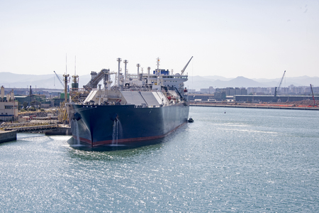 Foto per Partial view of Barcelona harbor with cargo ship in foreground - Immagine Royalty Free
