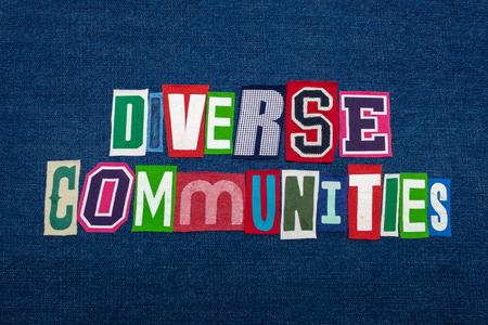 DIVERSE COMMUNITIES text word collage, multi colored fabric on blue denim, community diversity concept, horizontal aspect