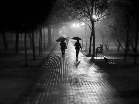 people walking under rain and fog
