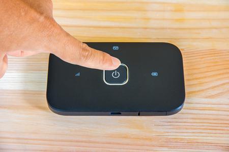 Foto de turn on and off pocket wifi switch - Imagen libre de derechos