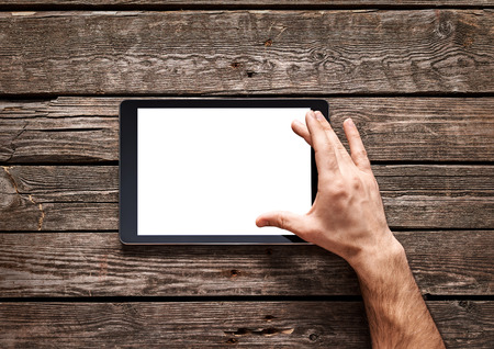 Photo pour Man use a spread gesture on touch screen of digital tablet.  - image libre de droit