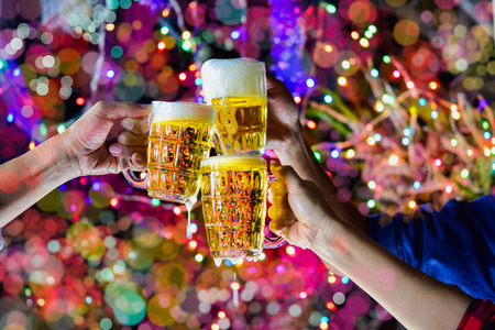 Foto de Celebration with a beer mug background bokeh is a concept of celebration and social gatherings. - Imagen libre de derechos