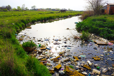 Foto de River that is polluted with various garbage and trash, Polluted rivers, photography - Imagen libre de derechos
