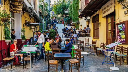 Photo for ATHENS, GREECE - NOVEMBER 6, 2015: Scenes from Plaka, also called Neighbourhood of the Gods, the old district of Athens at the foot of the Acropolis with labyrinthine streets and neoclassical architecture. - Royalty Free Image