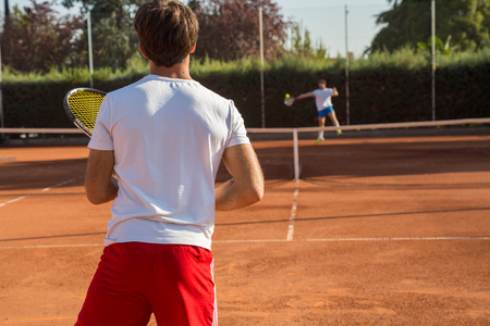 Photo pour Professional tennis player man playing on court in afternoon. - image libre de droit