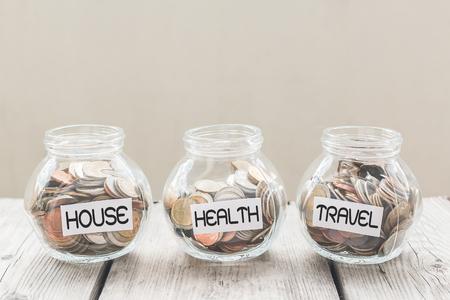 Photo pour Money jar with coins on wood table , Saving Concept - image libre de droit