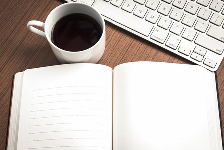 Photo pour Empty notebook , keyboard and coffee on wood table   workplace concept - image libre de droit