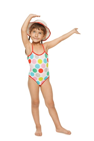 Full length of little girl in swimsuit and panama hat with hands raised, isolated over white background.