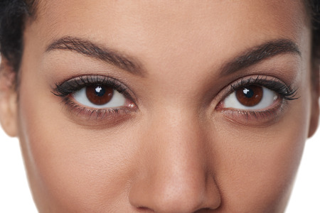 Photo pour Cropped closeup image of breathtaking female brown eyes staring at you - image libre de droit